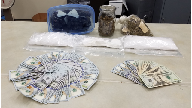 Officials: Four pounds of drugs and over eight thousand dollars in cash seized in drug bust