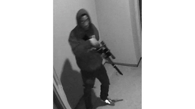 Police need help finding man caught on camera with rifle